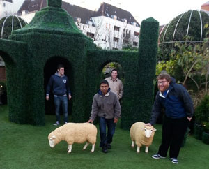 Students in an English Garden with some sheep