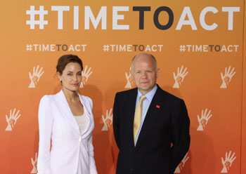 angelina jolie and foreign secretary william hague at the global summit to end sexual violence in conflict