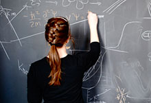 student working at chalkboard