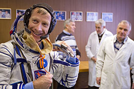 Drexel Alumni and Astronaut Christopher Ferguson goes through a suit fit check