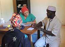 Drexel Chemistry Major Victoria Smith with a doctor and patient in a hospital in The Gambia