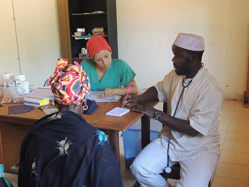 Drexel Chemistry Major Victoria Smith a doctor and a patient at a hospital in The Gambia
