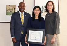 Drexel Provost Brian Blake and Senior VP for Faculty Affairs Erin Horvat giving an award to Professor Zoe Zhang