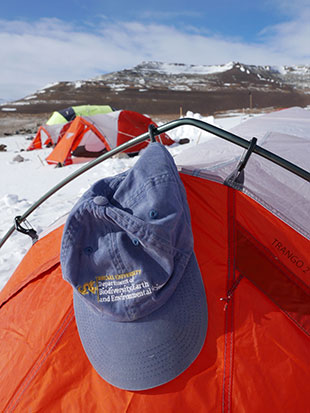 Ted Daeschler's Drexel hat hanging on a tent in Antartica