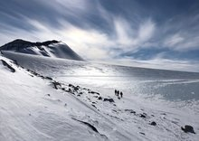Scientists walking across a glacier