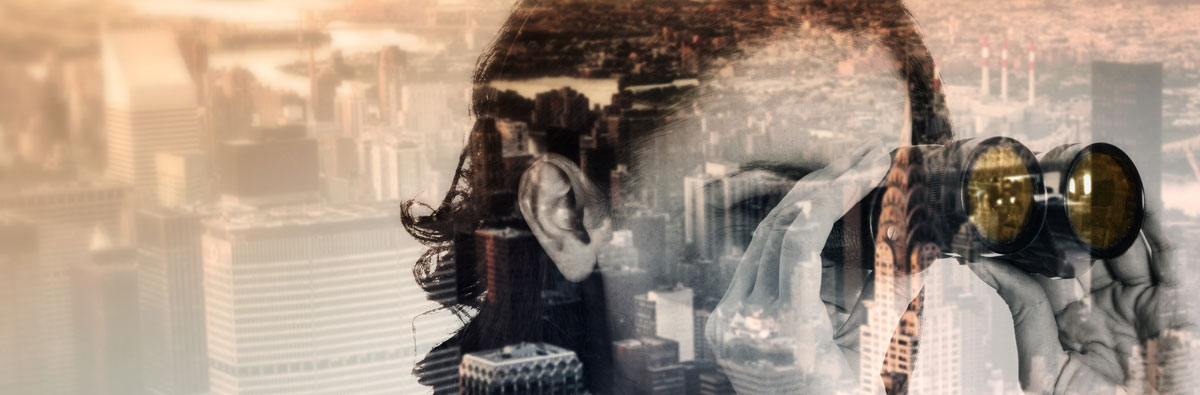 Composite image of a woman looking through binoculars imposed over a arial view of a city