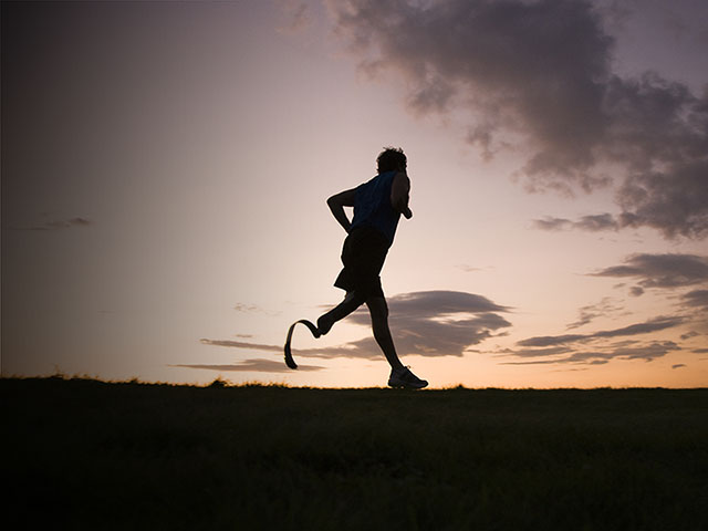 Man with prosthetic running