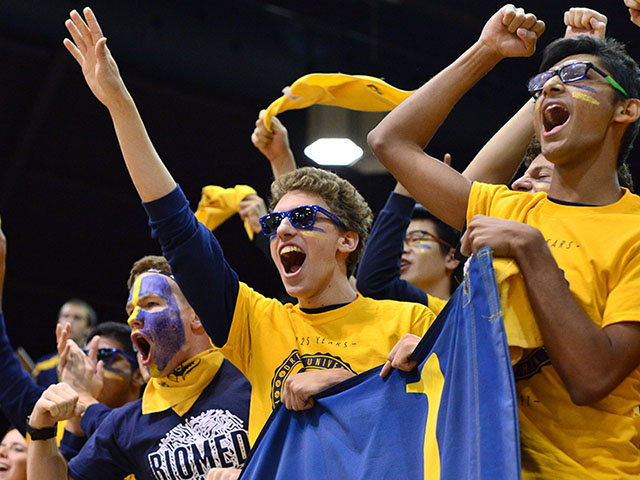 Drexel students cheering during an athletic event