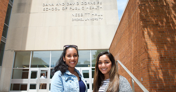 Two students in front of Nesbitt Hall