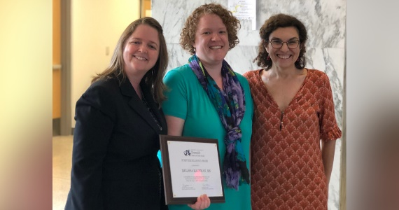 Melissa Kaufman is presented with the 2019 Dornsife Staff Excellence Award