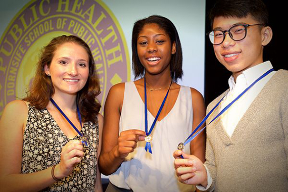 Photo of three students at Welcome Ceremony