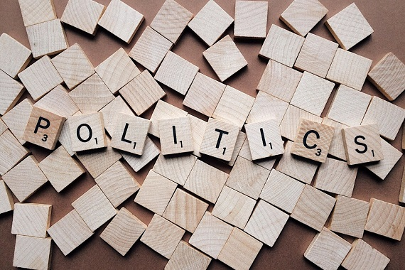 The word politics spelled with wooden letters