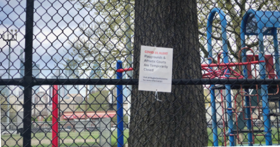 A Philadelphia playground sign says it is closed because of COVID-19