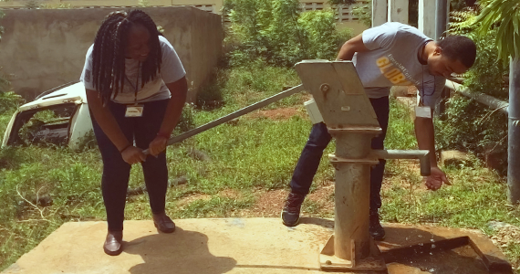 dornsife global students pumping water at a new well in Africa