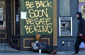 "shop boarded up with sign that say ""Be back soon. Be safe. Be kind."""