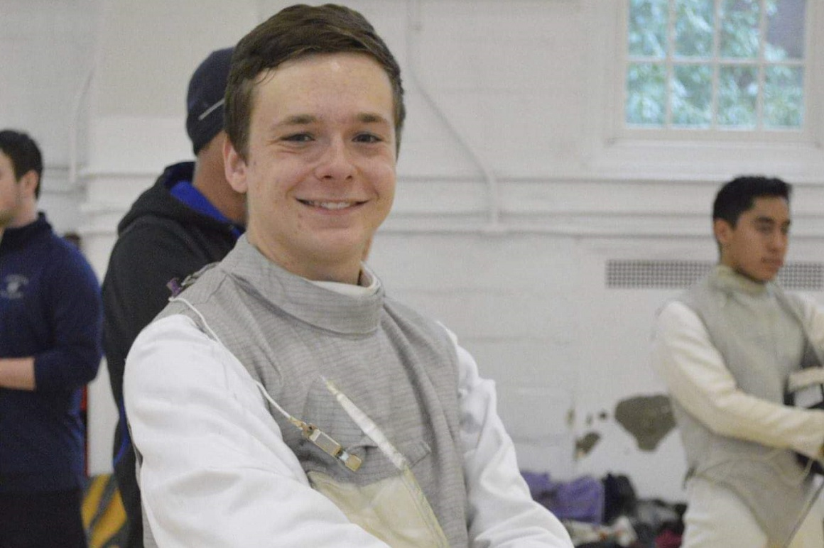 Troy at a fencing club tournament