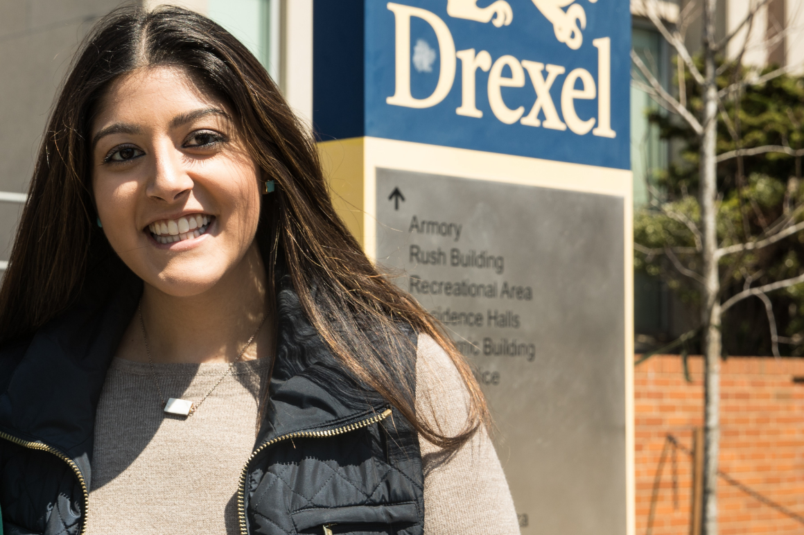 Elina smiling in front of Drexel building
