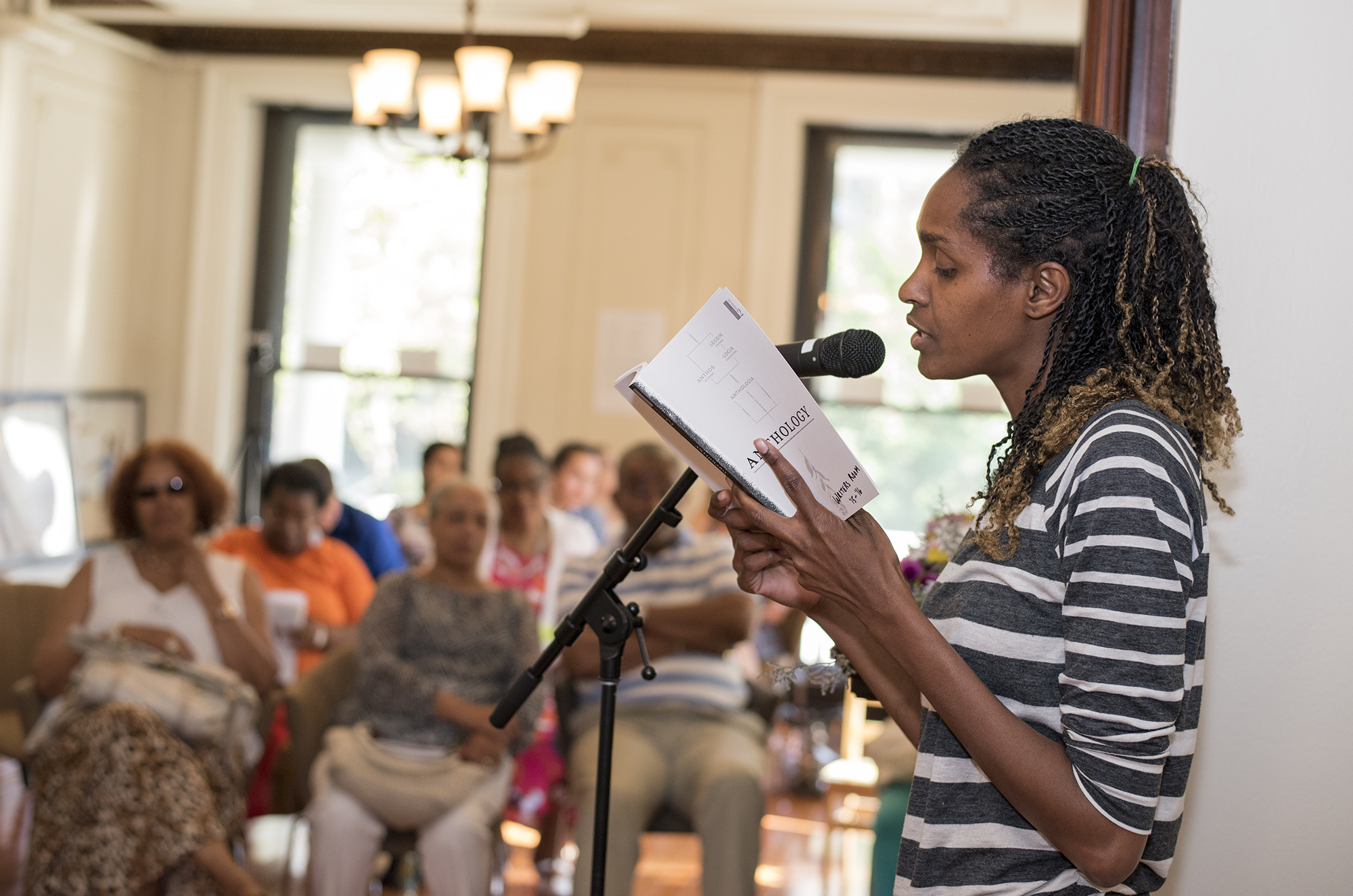 A Writers Room participant reads her work for the program's Anthology release event