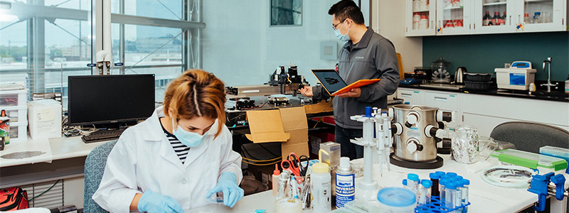 Researchers working in an engineering lab