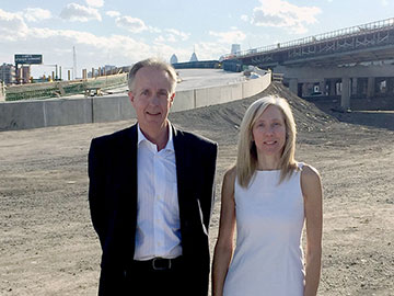 Elaine Elbich '88 works with  Bob Crawford '85, '87 on the I-95 Girard Avenue interchange project.