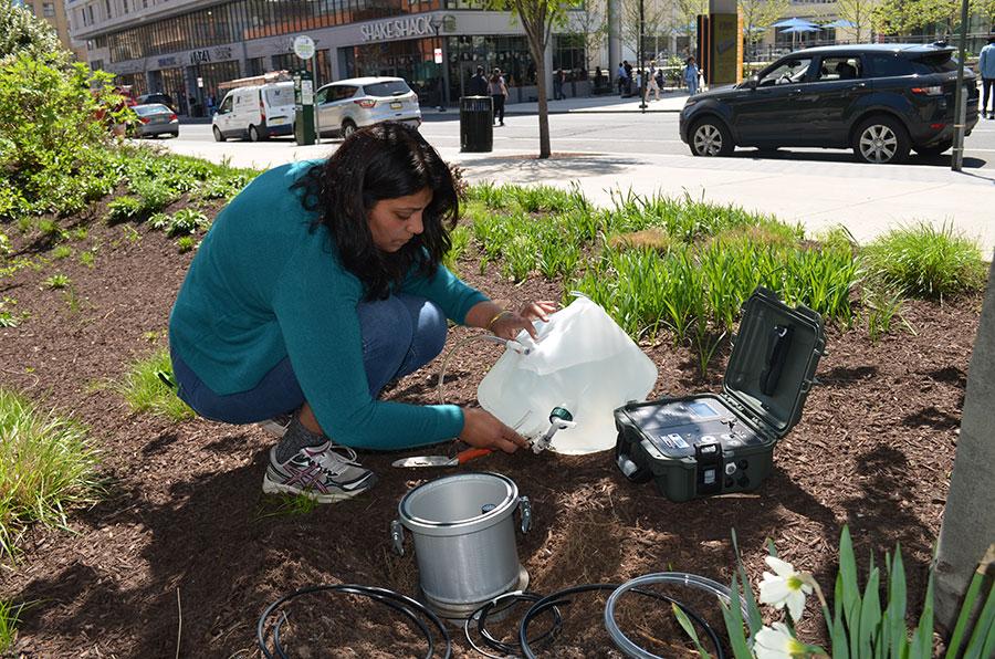Leena Shevade monitors water drainage.