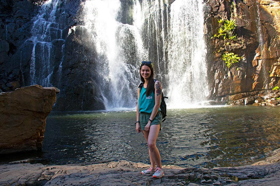 Student at a national park waterfall in Australia.