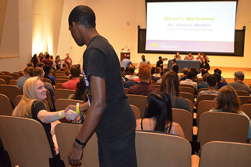 Dean Walker encouraged students to greet one another.