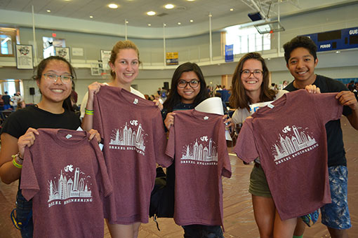 New students show off their t-shirts.