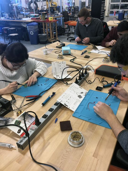 Students working on electronics project.