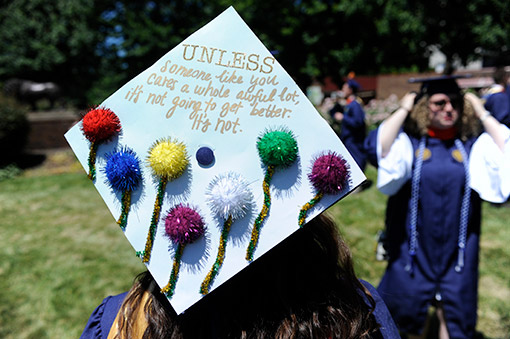 Some graduates embellished their mortarboards.