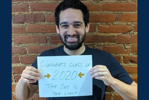 Goodwin advisor with a sign congratulating the class of 2020