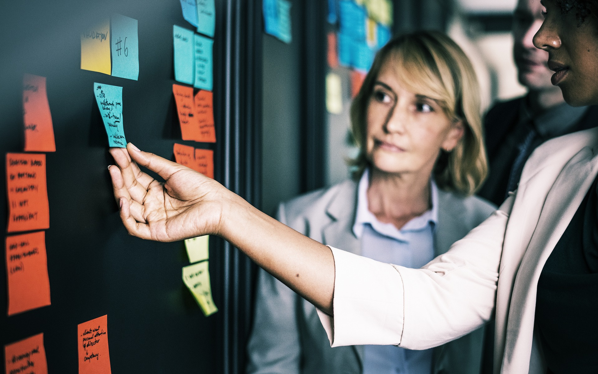 women at board with post its
