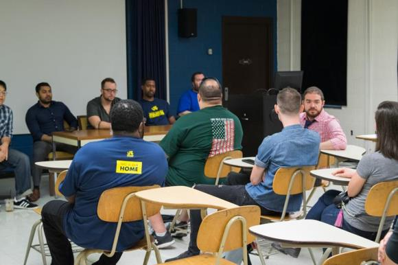 Military Transition Program students listen to former students during a Welcome Week panel.