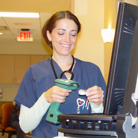 Female nurse student with wand and computer