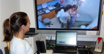 Nursing student watching observation monitor