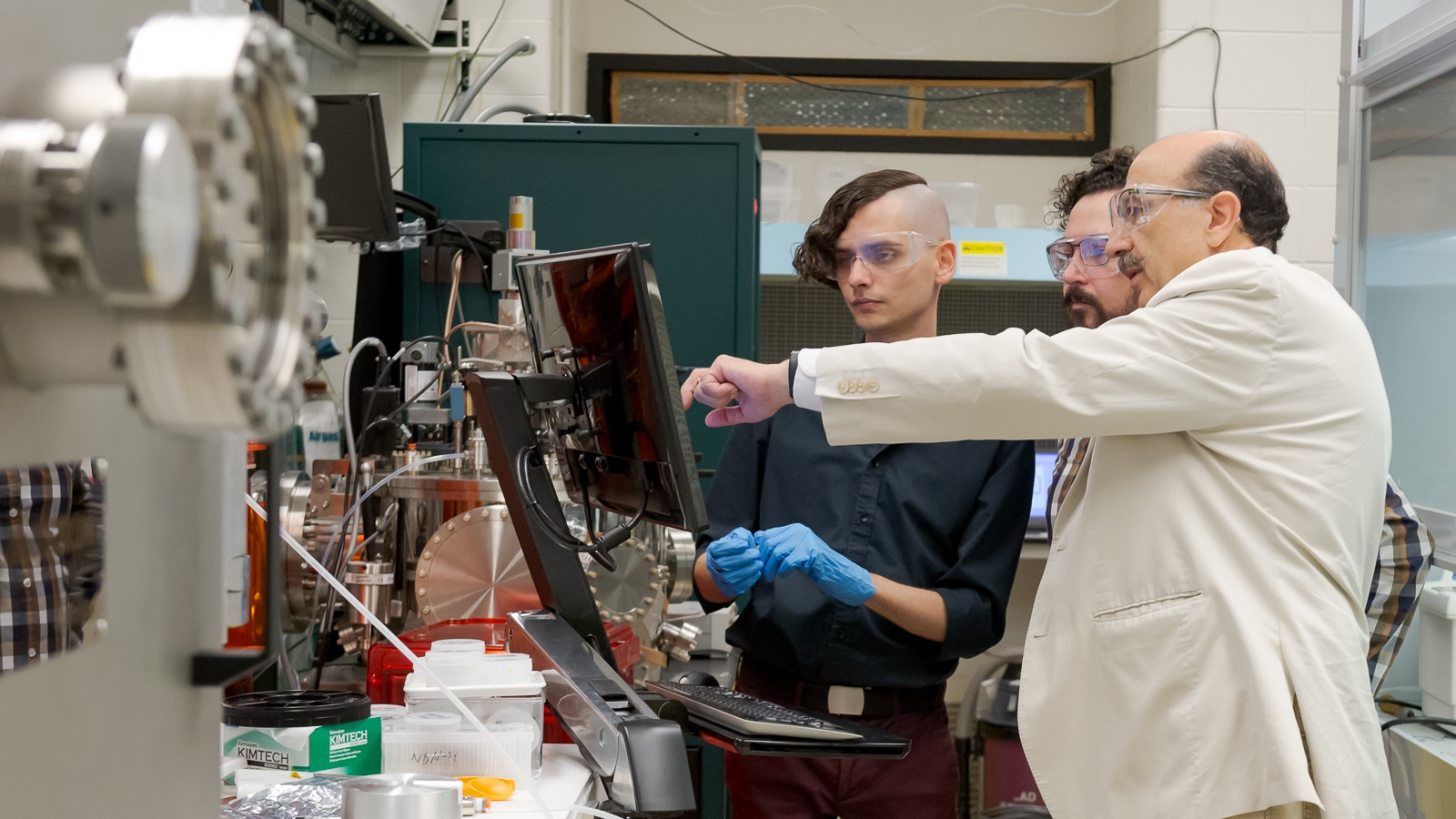 Argonne scientists at nanowire fabrication machine