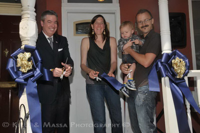 Ribbon cutting ceremony for first house bought under the Home Purchase Assistance Program