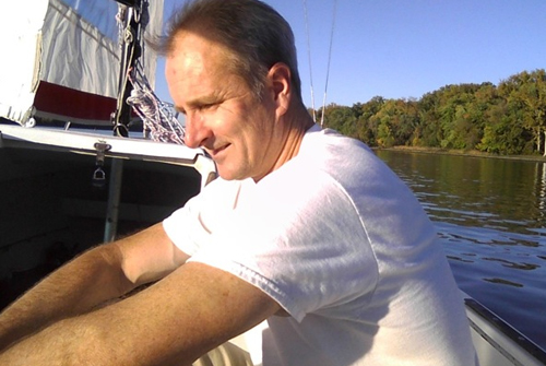 Professor Lloyd Ackert on his sailboat