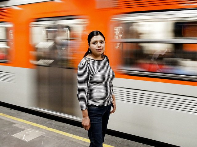 Picture of woman waiting on bus platform