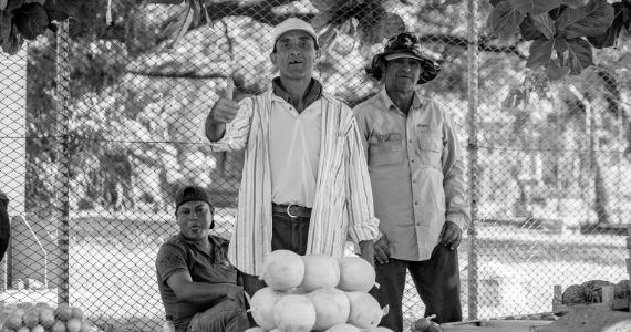 men in Latin America selling fruit
