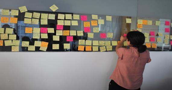 women with post-it board