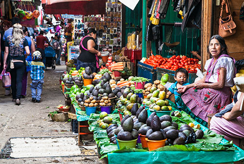 Photo of a vender at an open market in Latin America