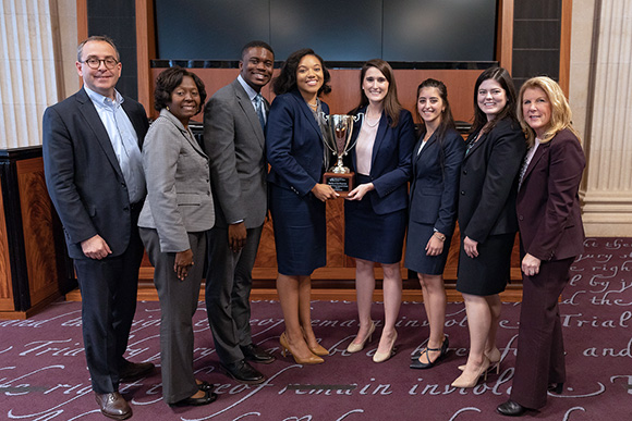 Maryland University Carey School of Law students pose with the tournament trophy.