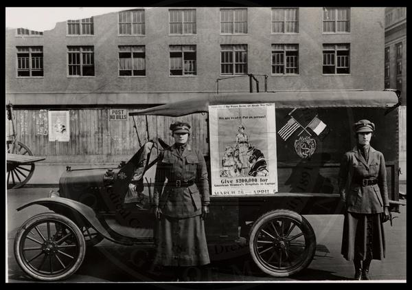 American Women's Hospital Service workers in front of ambulance. (The Legacy Center Archives and Special Collections)