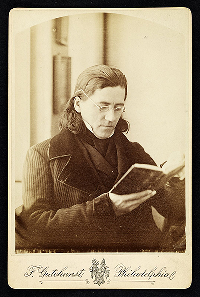 Portrait of Constantine Hering holding a book. (The Legacy Center Archives and Special Collections)