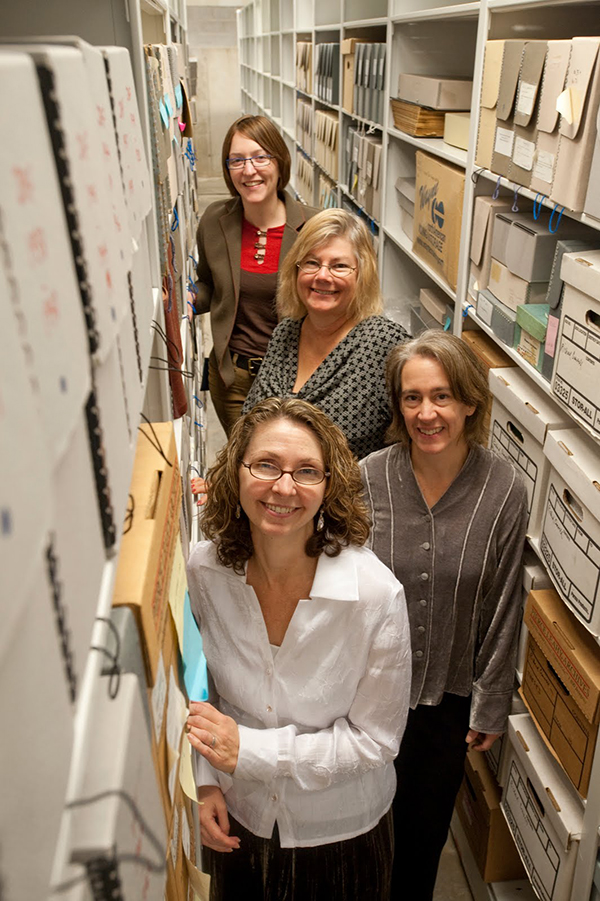 Archives staff in the stacks. (The Legacy Center Archives and Special Collections)