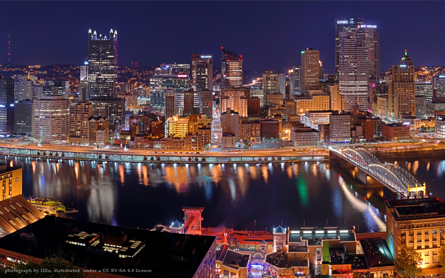 Pittsburgh skyline at night, shown as a case study in The New Localism