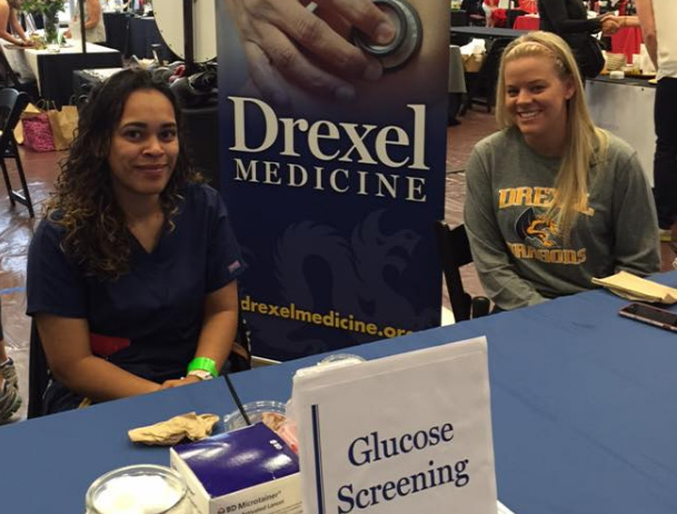 Drexel Medicine staff providing free medical screenings at the annual Philly BeWell Boot Camp event.