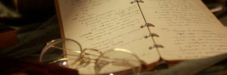 Antique eye glasses and vintage medical student notebooks from the archives at Drexel University College of Medicine.