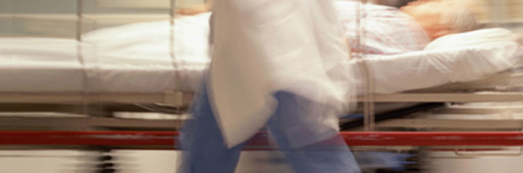 Blurred emergency patient being moved in a hospital.
